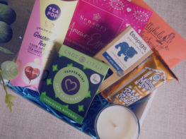 Vegan friendly care package, gift box containing vegan friendly food, drinks and pamper treats