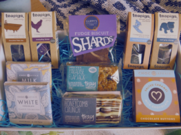 large tea and treats gift hamper, including four teapigs teas, two tray bakes, two chocolate bars and salted caramel buttons- presented in a a white gift box