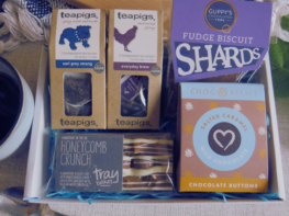 Tea and Treats Care Package- Tea Break In A Box, contents, two teapigs tea pouches, honeycomb tray bake bar, salted caremel buttons and fudge and biscuit chocolate shards